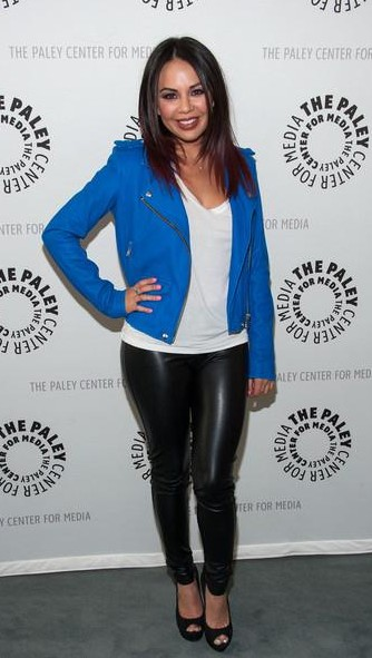 Looking for the white t-shirt with blue jacket and black pants that Janel Parrish is weaing - SeenIt