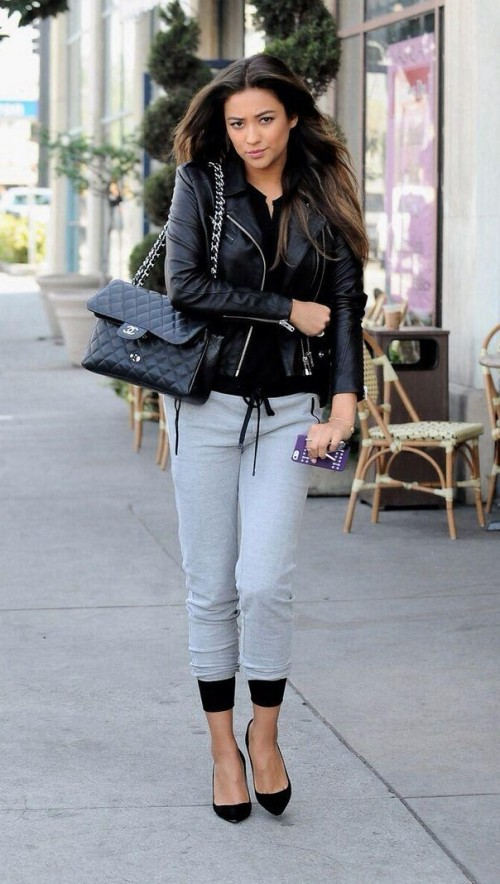 Looking for black top, biker jacket, gray joggers, black sling bag that Shay Mitchell is wearing - SeenIt