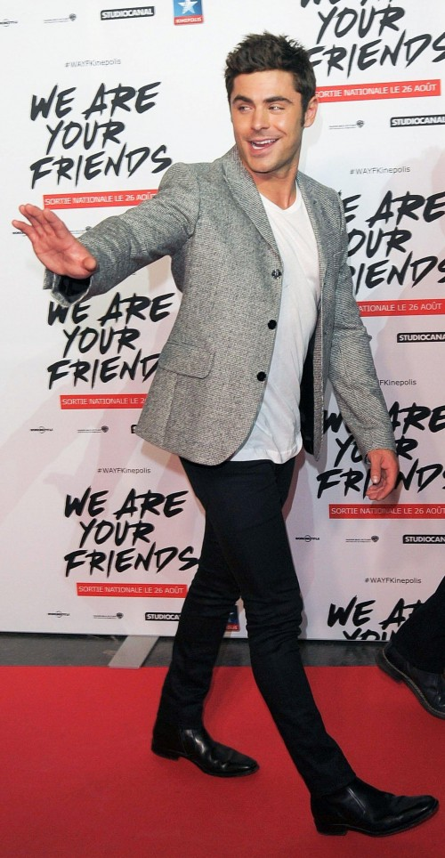 Looking for the grey blazer with white tee, black jeans and Oxford that Zac Efron is wearing - SeenIt