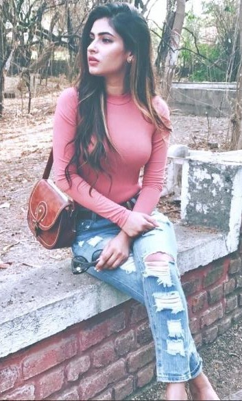 Want a similar pink top, blue ripped jeans and a brown sling bag like the one which Karishma Sharma is wearing - SeenIt