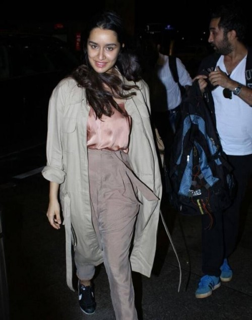 Want the nude outfit which Shraddha Kapoor is wearing along with the trench coat and black sneakers - SeenIt