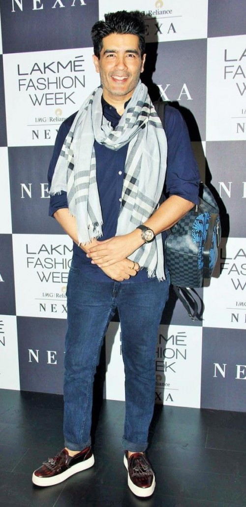 Yay or Nay? Manish Malhotra spotted wearing a blue shirt and denim jeans paired with a plaid scarf  on day 1 of the Lakme Fashion week , Mumbai - SeenIt