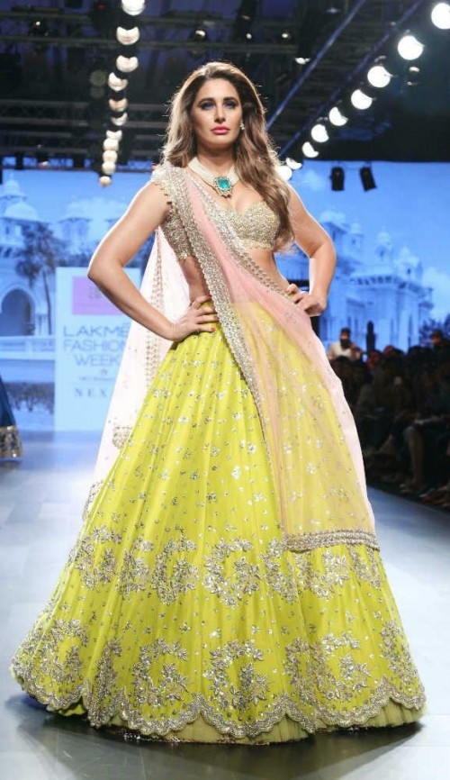 Yay or Nay? Nargis Fakhri walked the ramp for Anushree Reddy in a green embellished lehenga during the Lakme Fashion Week - SeenIt