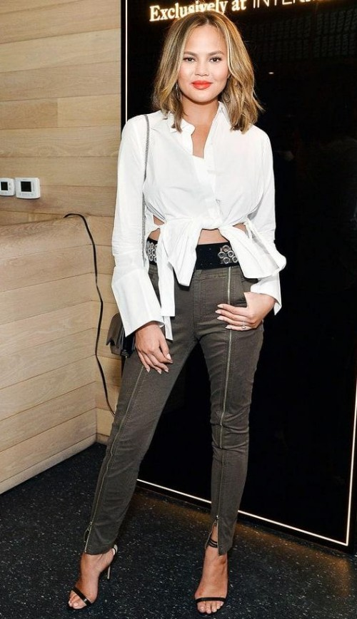 Chrissy Teign's white shirt and olive green pants are what I am looking for. - SeenIt