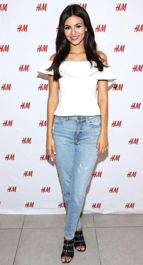 Looking for a similar white off shoulder ruffled top and blue jeans like Victoria Justice is wearing. - SeenIt