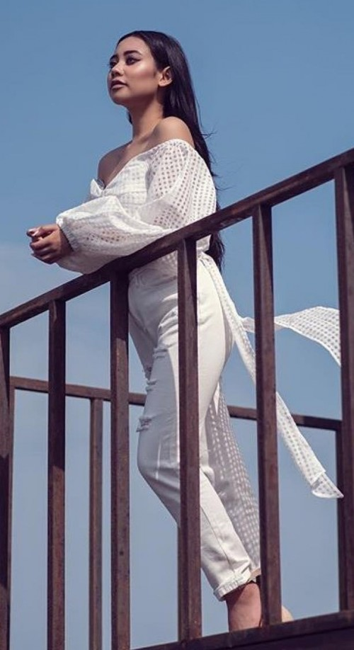 Looking for this white off shoulder mesh top and trousers online. - SeenIt