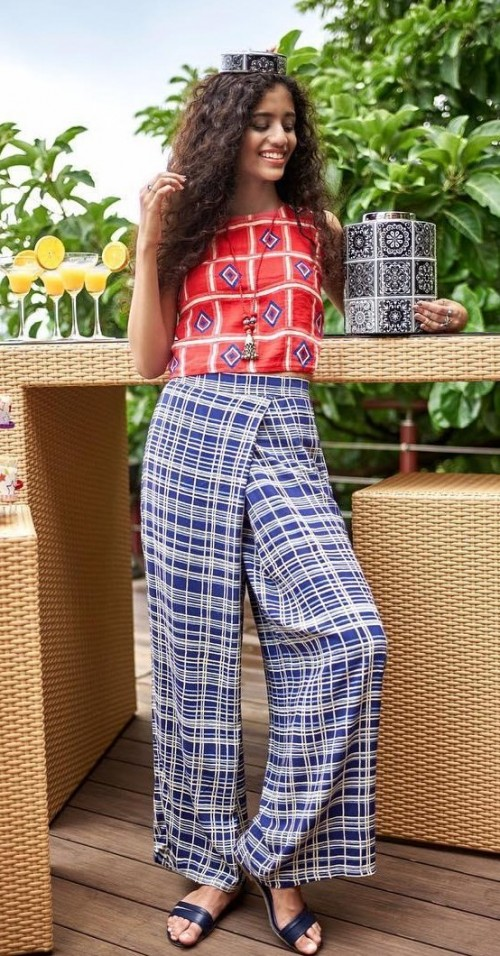 Help me find this blue and white checked pants and red geometric print crop top. - SeenIt