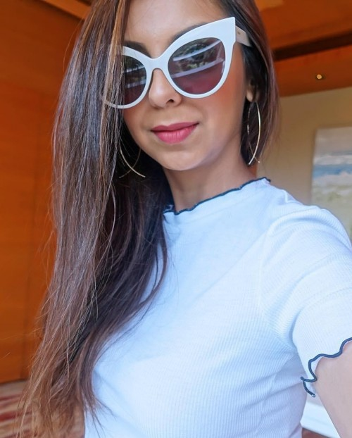 Looking for a similar white cat-eye sunglasses as seen in Aanamc - SeenIt