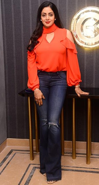 b3467c9e50b9 Looking for a similar orange cold shoulder ruffled top and navy blue flared jeans  like Sridevi