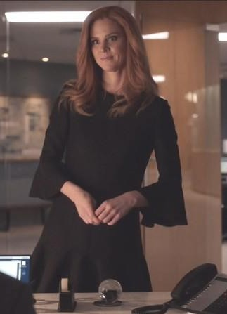 Donna's black bell sleeve skater dress is what i am looking for online - SeenIt