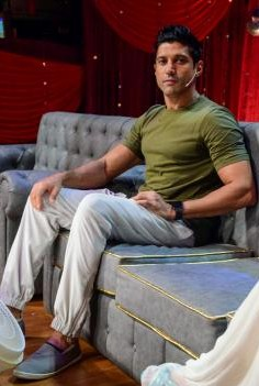looking for a similar round neck green tee , white pants and espadrilles like Farhan Akhtar is wearing at the promotions of his upcoming movie Lucknow central - SeenIt