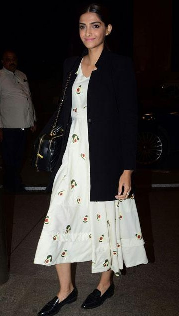I want a similar white printed midi midi dress, black coat and loafers like Sonam Kapoor is wearing. - SeenIt