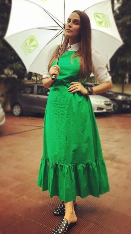Looking for this green frilled dress and white shirt like Neha Dhupia is wearing. - SeenIt