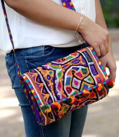 Looking for this multicolour pompom sling bag - SeenIt