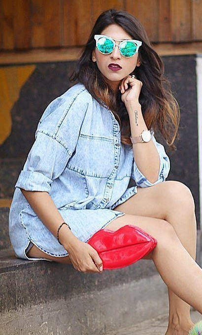 Help me find a similar denim shirt like styleonwings is wearing along with the red lips clutch. - SeenIt