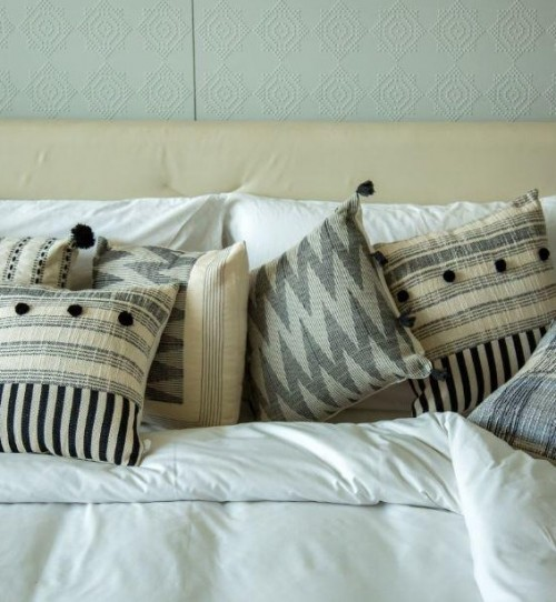 Help me find such black and white ikat cushions online..Indian website please..TIA - SeenIt