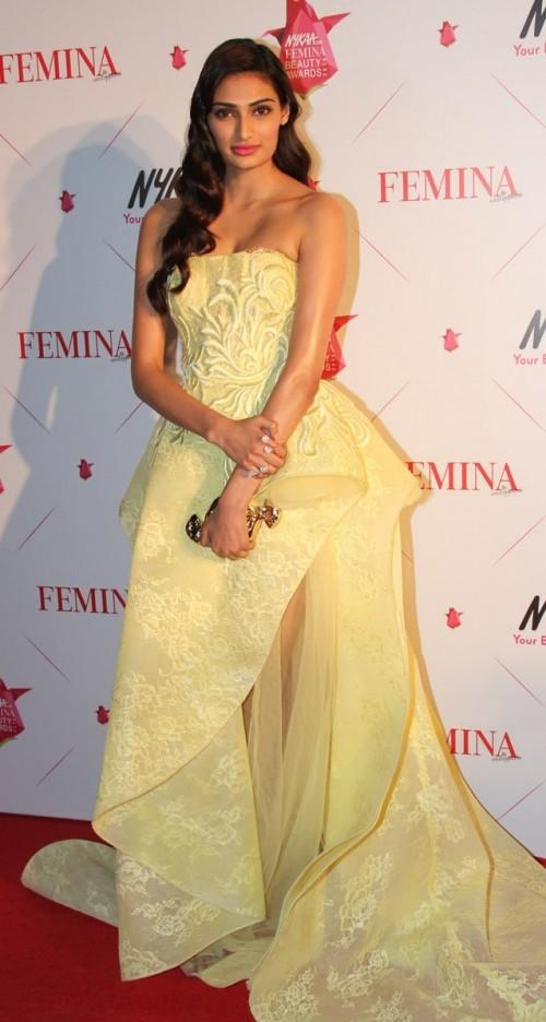 Athiya rocking thesherbet yellowSaiid Kobeisygown and the perfect coral lip! Yay or Nay? - SeenIt