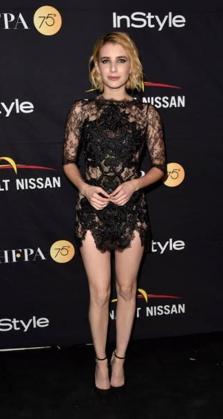 Yay or Nay? Emma Roberts wearing a short black lace embellished dress attends the HFPA & InStyle annual celebration of the Toronto International Film Festival - SeenIt