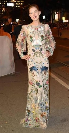 Yay or Nay? Rosamund Pike attends the 'Hostiles' premiere wearing a printed full length dress during the Toronto International Film Festival - SeenIt