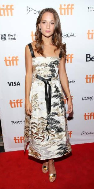 Yay or Nay?  Alicia Vikander wearing a printed midi dress attends the premiere of 'Euphoria' during the Toronto International Film Festival - SeenIt