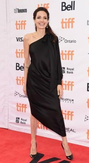 Yay or Nay? Angelina Jolie wearing a black one shoulder slit dress attends the 'First They Killed My Father' premiere during Toronto International Film Festival - SeenIt