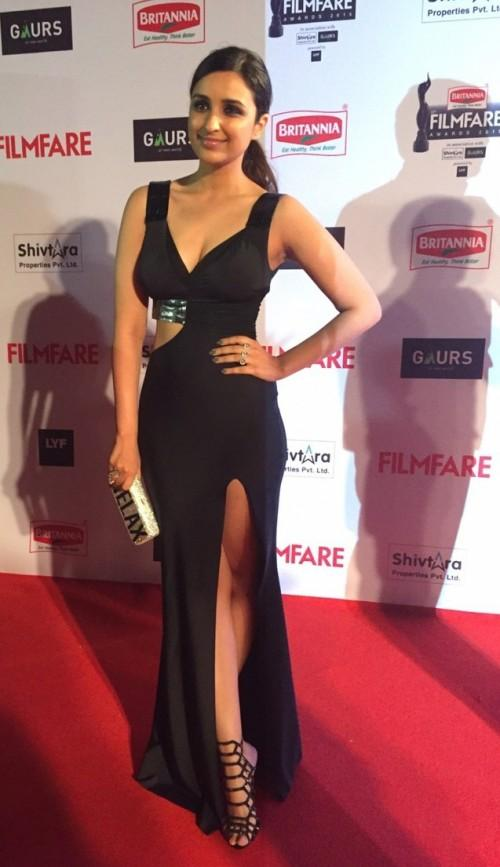 Parineeti flaunting her perfect curves and oh-so-fit body in her Shivan and Narresh gown.  - SeenIt