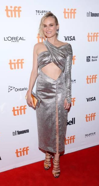 Yay or Nay? Diane Kruger wearing a silver metallic cut out dress attends the 'In the Fade' premiere during the Toronto International Film Festival - SeenIt