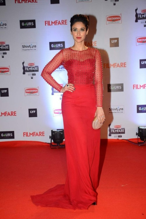 Another red for the night! Ileana looking stunning in this Nachiket Barve gown :) - SeenIt