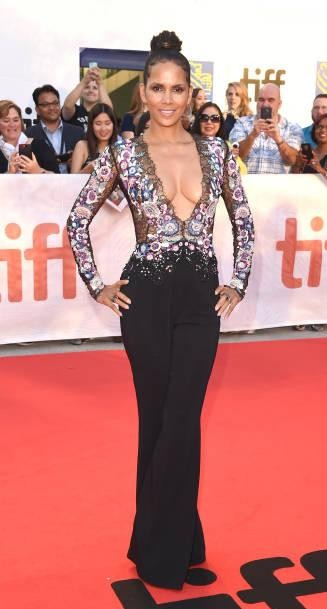 Yay or Nay? Halle Berry attends the 'Kings' premiere wearing a sheer embroidered black top and black trousers during the Toronto International Film Festival - SeenIt