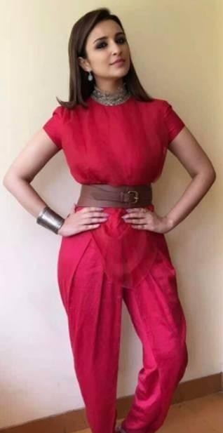 Looking for this red jumpsuit that Parineeti Chopra is wearing - SeenIt