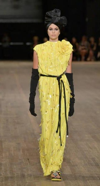 Yay or Nay?  Kaia Gerber wearing a yellow gown with black gloves walks the runway for Marc Jacobs SS18 fashion show during New York Fashion Week - SeenIt