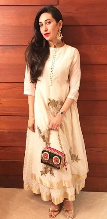 Looking for this off white embroidered anarkali and golden pants like Karisma Kapoor is wearing. - SeenIt