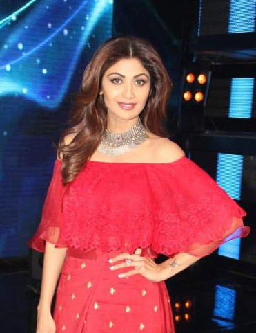 Looking for this red off shoulder cape top that Shilpa Shetty is wearing - SeenIt