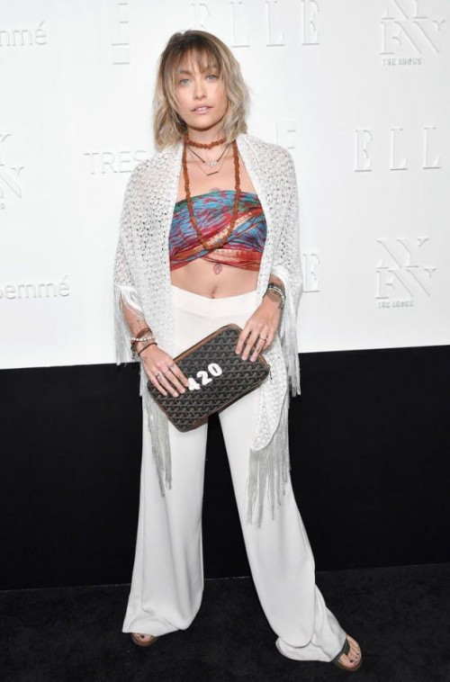 Yay or Nay? Paris Jackson wearing white pants with a bralet and crochet cape at the Elle + E! + IMG host celebration party during the New York Fashion Week - SeenIt