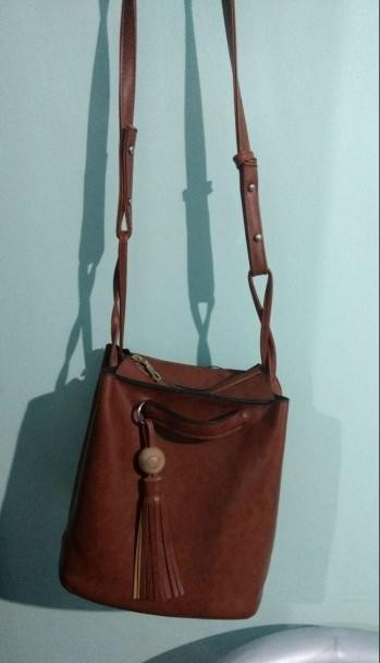 I am looking for similar brown bucket shape sling bag - SeenIt