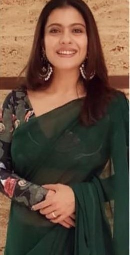 Want a similar green georgette saree and printed blouse like the one which Kajol is wearing for ganesh chaturthi celebrations - SeenIt