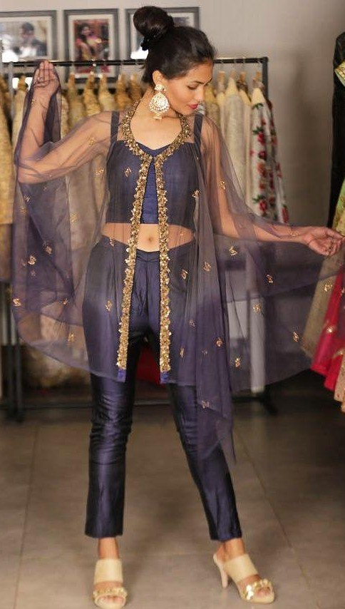 Looking for this navy blue crop top and pants with sheer embellished cape. - SeenIt