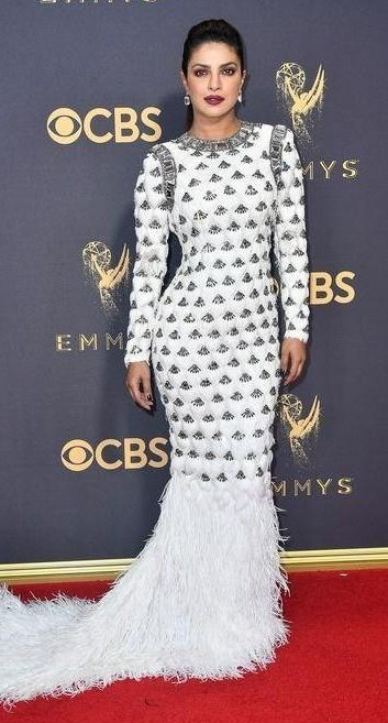 Yay or Nay? Priyanka Chopra wearing a white embellished feather trail mermaid gown by Balmain at the Emmy awards last night - SeenIt