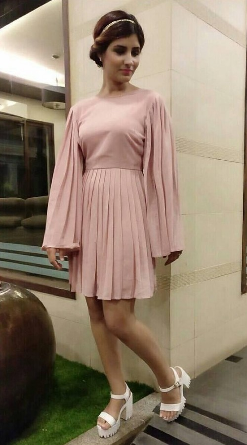 Would love to have this pink pleated dress. - SeenIt