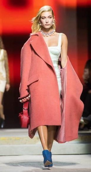 Yay or Nay?  Hailey Baldwin wearing a pink over coat walks the runway at the TOPSHOP show during London Fashion Week - SeenIt