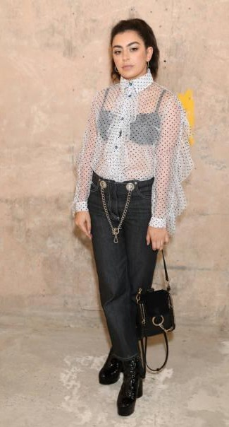Yay or Nay? Charli XCX attends the House of Holland show wearing a polka dot sheer shirt with pants during the London Fashion Week - SeenIt