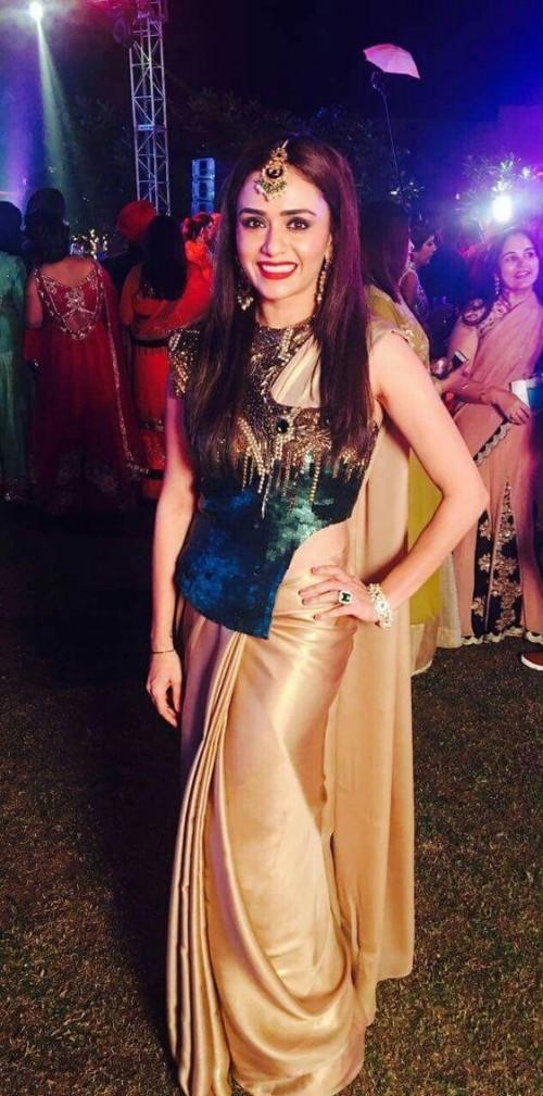 Want a similar golden draped saree - SeenIt