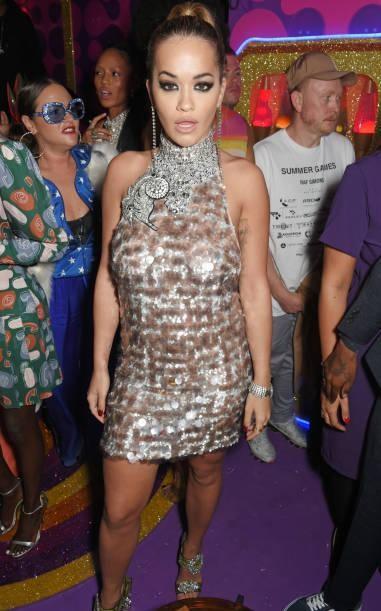 Yay or Nay?  Rita Ora attends the LOVE magazine x Miu Miu party wearing a short dress , held during London Fashion Week - SeenIt
