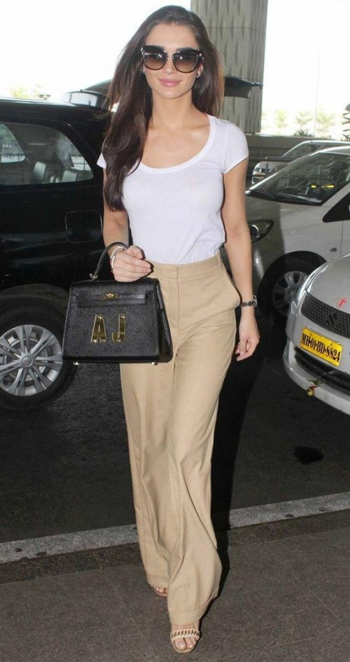 Looking for the white top and beige palazzo that Amy Jackson is wearing - SeenIt