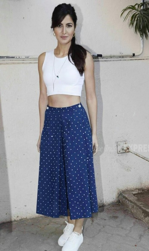 Want the white croptop, blue polka dot pants and white sneakers which Katrina Kaif is wearing - SeenIt
