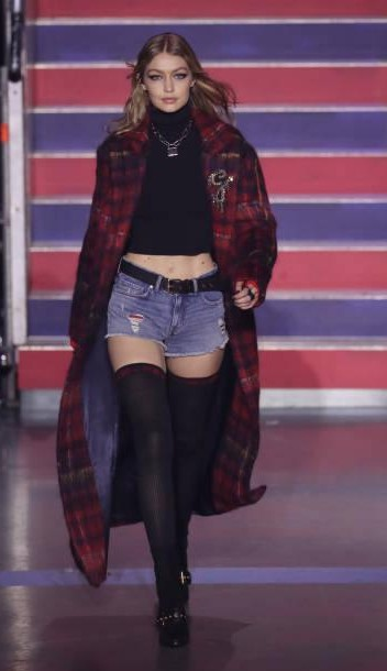 Yay or Nay? Gigi Hadid wearing an over coat with shorts walks the runway at the Tommy Hilfiger show during London Fashion Week - SeenIt