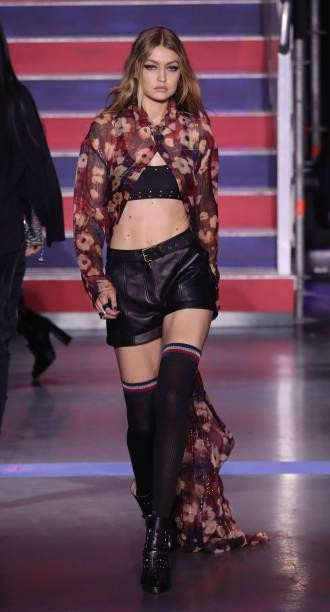 Yay or Nay? Gigi Hadid wearing a pair of black shorts and printed cape walks the runway at the Tommy Hilfiger show during London Fashion Week - SeenIt
