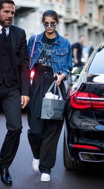 Yay or Nay? Taylor Hill wearing denim jacket, pink Gucci bag, high waisted pants is seen outside Alberta Ferretti during Milan Fashion Week - SeenIt