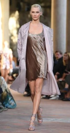Yay or Nay? Karlie Kloss wearing a short shimmer dress and over coat walks the runway at the Alberta Ferretti show during Milan Fashion Week - SeenIt