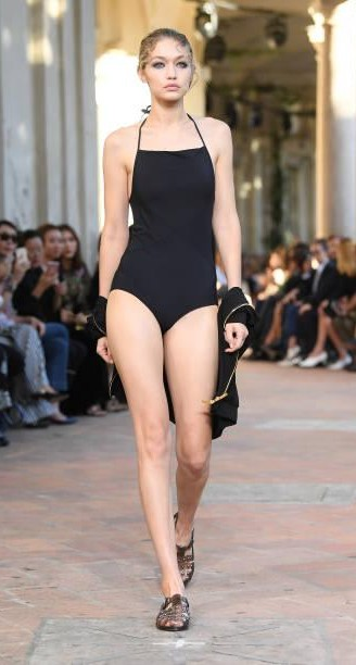 Yay or Nay? Gigi Hadid wearing a black swimsuit walks the runway at the Alberta Ferretti show during Milan Fashion Week - SeenIt